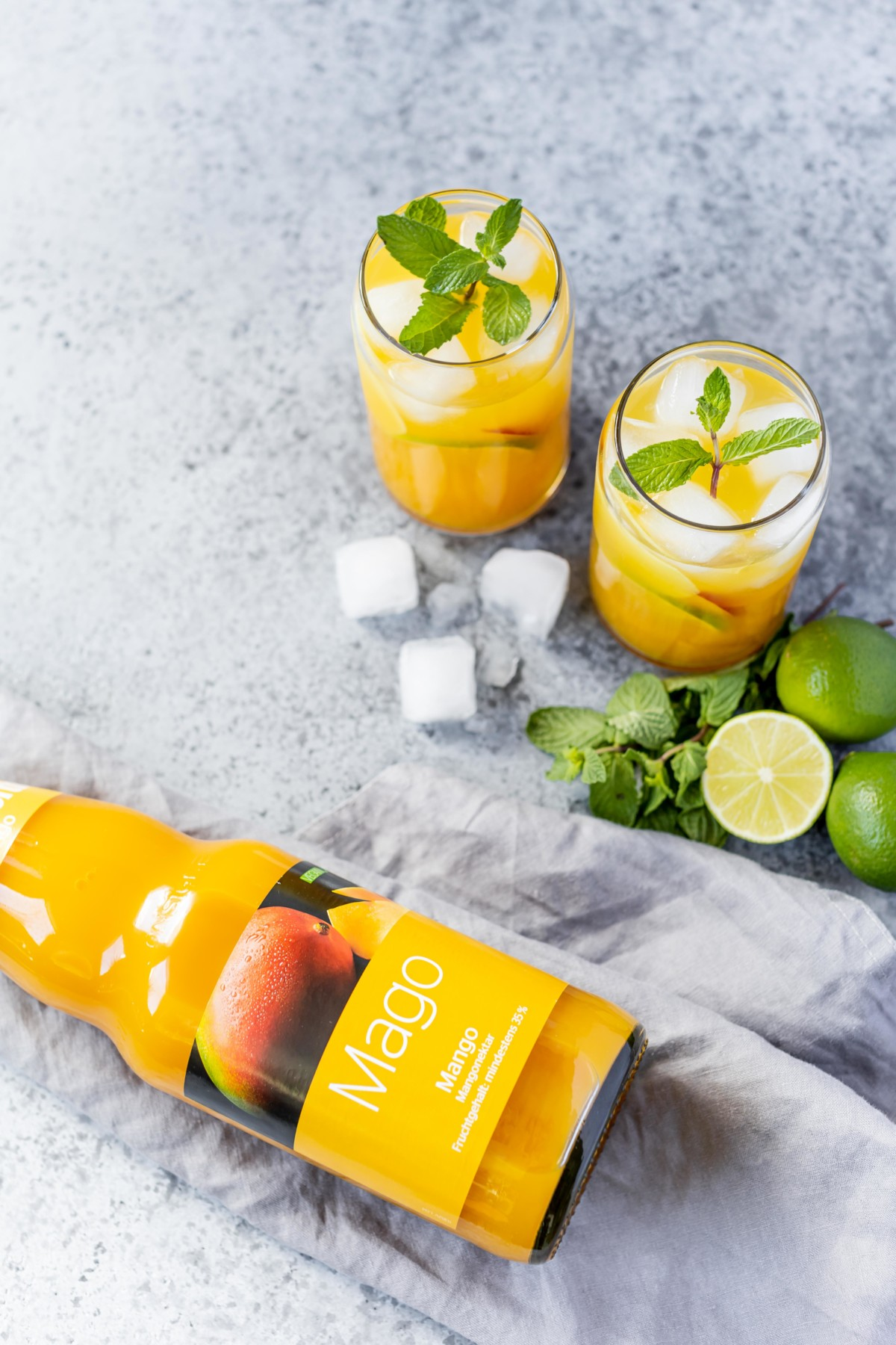 Mango Gin(ger) Fizz mit Limette // Mango Gin Fizz with Ginger and Lime by https://babyrockmyday.com/mango-gin-fizz/